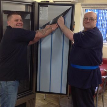 Peeling off the film on the new refrigerator at Friends of Hardie Park - Stanford Le Hope